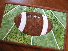 Pay for pattern:  Pigskin Mug Rug pattern on Craftsy.com