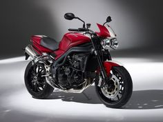 Speed Triple SE: The original street fighter gets Tornado Red paint with a Crystal White center stripe, plus matching seat cowl and flyscreen