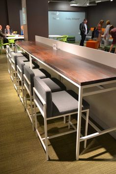 The 7900 series table with the 9660 bar height stools from the Comida collection. The table features a new distressed wood finish that's on trend. Visit at #NeoCon2013 in showroom 11-111 to learn more.