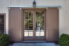 Home Decor, Big And Elegant House With Barn Door Style That Look So Cute And Amazing With The Beautiful And Unique Design Ideas For The Front Door With Two Green Bushes In The Edge That Look So Leafy And Fresh ~ Furnish Your Room With Using Barn Door Style Like This