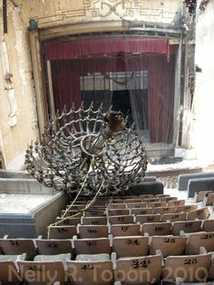 Interior of the abandoned Ciné Ópera movie theater in Mexico City, Mexico. It opened on March 11 of 1949. It was one of the most popular theaters in Mexico City for decades. From 1993-1998, it was a concert hall. It closed in 1998. It was supposed to be turned into a cultural center, but it is in such an advanced state of deterioration that all such plans have stalled due to lack of funding.