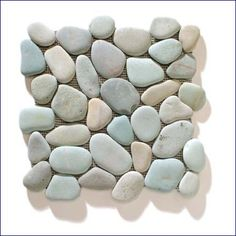 Try pebble mosaics on the floor of your new shower stall. They'll add a whole new sensory experience to your morning routine.    Ocean stone tiles in Turquoise, $13/sq ft, Kuda Imports.