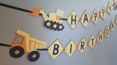 I absolutely adore this construction themed birthday banner. My toddler is currently obsessed with excavators so Im thinking this may even be his third birthday theme. :)  This listing is for a HAPPY BIRTHDAY banner. There are two excavators flanking the HAPPY banner and two dump trucks flanking the BIRTHDAY banner. Each square is 6 inches in width and height. There are three layers on each: yellow, black, yellow. The banner will not ship on the ribbon. Once the squares are tied using the…