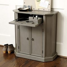"""Leighton Charging Console $399.00 Ballard Designs.  Charging unit hidden in top panel.  Useful!  Dimensions are good  32""""H X 30""""W X 13""""D, dark gray or white."""