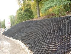 Typar™ geocell slope stabilization is a cellular confinement system for stabilizing soil on slopes by confining the soil particles within the permeable cells. Typar™ geocell is the perfect solution where slope erosion is a major issue. Steep Hillside Landscaping, Landscaping On A Hill, Landscaping With Rocks, Landscaping Ideas, Landscaping Software, Farmhouse Landscaping, Luxury Landscaping, Landscaping Company, Outdoor Landscaping