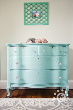 Vintage dresser painted aqua is perfection in the nursery!