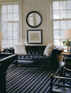 Porthole Mirror Above Map decor, mirror, color, leather sofa, chesterfield, white rooms, design, black, victoria hagan