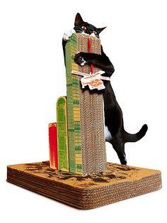 cat scratching post - he'll think he's godzilla or kingkong - too cute! thinkgeek.com $30-