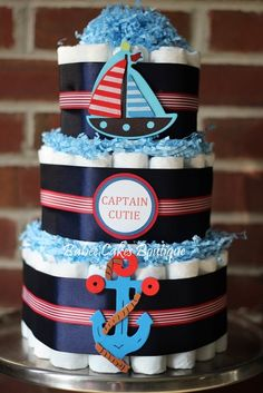 3 Tier Captain Cutie Nautical Diaper Cake, Red and Navy, Boy Baby Shower, Sailboat, Anchor, Nautical Baby Shower, Baby Shower Centerpiece - http://www.babyshower-decorations.com/3-tier-captain-cutie-nautical-diaper-cake-red-and-navy-boy-baby-shower-sailboat-anchor-nautical-baby-shower-baby-shower-centerpiece.html