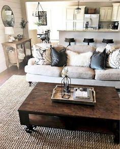 Adorable 35 Cozy Rustic Farmhouse Living Room Decor Ideas https://homeideas.co/576/35-cozy-rustic-farmhouse-living-room-decor-ideas #interiordesigntipslivingroom #InteriorDesignRustic
