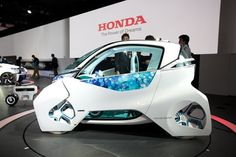 Honda debuted its quirky Micro Commuter Concept at the 2011 Tokyo Motor Show. Powered by a diminutive 22-hp electric motor, it has a range of 37 miles, a stop speed of 37 mph and goes from 0 to 37 mph in 7.4 seconds.
