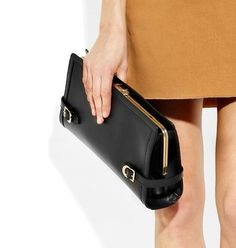 Bally Redgrave Clutch in black leather.