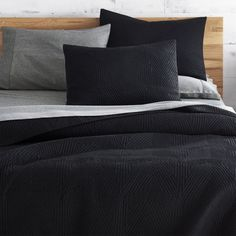 Free Shipping.  Shop Triangle Black Coverlet Full/Queen.   Concentric triangles quilt a fresh texture on soft cotton.  Triangle Black Bed Linens is a CB2 exclusive.