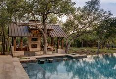 Ranch home backyard with pool and outdoor kitchen covered patio with metal roof. Geschke Group Architecture.