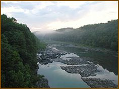 Twin Falls at Rock Island State Park - Tennessee = Caney Fork River, boat ramp, lake & river fishing, cabins, camping, events & programs, picnic, swimming, 2 picnic pavillions, badminton, basketball, horseshoes, ping-pong, playground softball, tennis, volleyball, board games