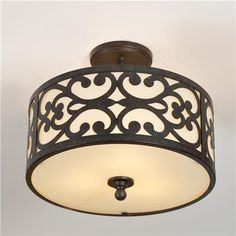 I love this Barcelona Semi-Flush Mount Ceiling light at Shades of Light. It has a matching pendant.