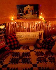 Maple paneling glows like amber in the bed-nook of this 1958 camp trailer.
