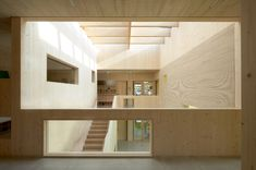Completed in 2018 in Neustadt an der Donau, Germany. Images by Stefan Müller-Naumann. All rooms of the kindergarten are grouped around a central inner playground with skylight. The inner playground opens wide to the forecourt to the. Atrium, Indoor Play Areas, Patio Interior, Multipurpose Room, Luxury Furniture Brands, Passive House, Main Entrance, Wood Construction, Skylight