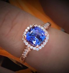 Fabulous cushion shaped Tanzanite set in delicate rose gold halo ring.... This beauty is a alternate choice in unconventional engagement rings.https://www.cobymadison.com/rose-gold-engagement-rings #engagementring #rosegold #tanzanite