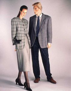 Woman's checked wool jacket, grey skirt, and black suede shoes, by Giorgio Armani, Italian, 1986. Man's jacket, trousers, shirt, and brogues, also by Giorgio Armani.