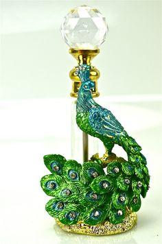 Enamel And Crystal Ornamented Peacock Perfume Bottle .