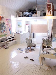 Melanie Parke's studio, attic, large space, wood floor, chair, mess, work space, home, desk, storage, balcony
