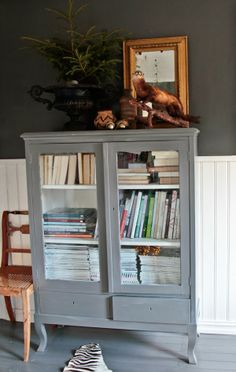 Wooden Unit filled with magazines in hallway?