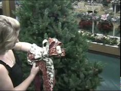 Making a double ribbon handmade tree topper bow at Keen's Floral Outlet, Scranton, PA