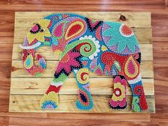 Tribal Elephant Colourful String Art Wall Art on rustic pine timber