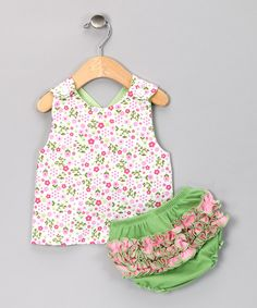 This set is as active as any little one and features a ruffled diaper cover that looks darling all on its own or when paired with the jumper. The jumper boasts two prints and colors that coordinate with the bottoms.Includes jumper and diaper cover100% cottonMachine washImported