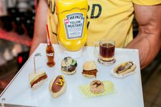 The menu from from Peter Callahan Catering included summertime favorites like sliders, hot dogs, and cheesesteaks, paired with mini bottles of Coca-Cola.  Photo: Paolo Ferraris/Michael Jurick Photography