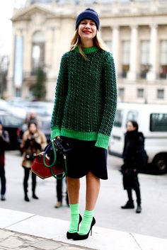 Street Style: Natalie Joos made a statement in an electric green sweater and matching socks at Paris Fashion Week Fall 2013. Via Fabsugar
