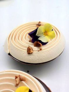 Pâtisserie Yann Menguy - imagine a piped roll like this but with the flavor changing through the center despite the same color. or even a super moist floral and mountainous nougat