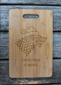 """Game of Thrones cutting board – Laser engraved wooden """"Christmas winter is coming"""" cheese board – Custom GOT, house Stark bread board by WoodLabMoldova on Etsy"""