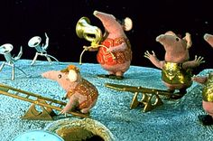 Clangers is a popular British stop-motion animated children's television series of short stories about a family of mouse-like creatures who live on, and in, a small blue planet (quite similar to, but not intended to be, the Moon). They speak in whistles, and eat green soup supplied by the Soup Dragon. The programmes were originally broadcast by the BBC from 1969–1972.  I believe they were revived with further series in 2002.
