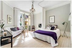 Спальня и гостиная в одной комнате: зонирование с помощью штор