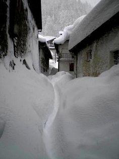 Snowy narrow street, Pragelato, Italy