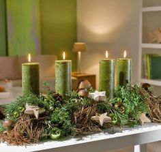 Perfect Christmas centerpiece or mantel decoration with green candles and gray moss! Centerpiece Christmas, Christmas Advent Wreath, Christmas Candles, Winter Christmas, Christmas Time, Christmas Crafts, Christmas Decorations, Xmas, Christmas Lights