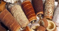 """For many people it's been known as Chimney cake but for Romanians and Hungarians it's known as """"Kürtöskalács"""" and is made from sweet, yeast dough, of which a strip is spun a… Cake Recipes, Dessert Recipes, Desserts, Chimney Cake, Oreo Cupcakes, Bread And Pastries, Mini Cakes, Cakes And More, Street Food"""