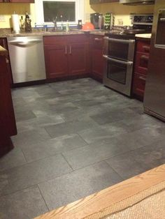 Pergo XP Monson Slate 10 mm Thick x 11-1/8 in. Width x 23-7/8 in. Length Laminate Flooring (18.36 sq. ft. / case)