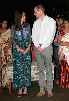 Catherine, Duchess of Cambridge and Prince William, Duke of Cambridge watch dancing by the fireside during a Bihu Festival Celebration at Diphlu River Lodge on day 3 of the royal visit to India and Bhutan on April 12, 2016 in Kaziranga, India.