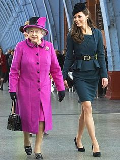 Queen in Bright Pink walking with Kate (the Duchess of Cambridge), the newest member of her family.