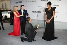 Photo: Hollywood producer Oscar Générale sought the hand of his companion Danny Mendez (Italian actress and first Miss Italy black) before the paparazzi to amfAR The Foundation gala dinner for AIDS Research at Cannes, alongside Mr & Mrs. John Travolta. -Producer Oscar Générale proposed to italian actress & first Black Miss Italy Danny Mendez on the red carpet at the Cannes Film Festival, next to John Travolta and his wife.