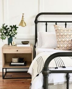 modern farmhouse master bedroom with iron bed and farmhouse bedding, nightstand decor with brass sconce, nightstand styling and neutral bedroom decor, rustic bedroom design Master Bedroom Design, Home Decor Bedroom, Bedroom Ideas, Bedroom Designs, Bed Ideas, Diy Bedroom, Bed Side Table Ideas, Trendy Bedroom, Neutral Bedrooms