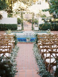 This bride chose to line her aisle with abundant greenery at the Darlington House in La Jolla, CA. (Bryan N. Miller Photography - as seen on Style Me Pretty)