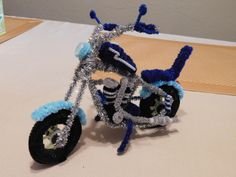 Blue Chopper.  This is one of the best pipe cleaner creations I've seen.  Very cool! yourlifeenhanced.net