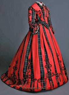 Dress ca. 1865–68. Black and coral satin with decorative trimmings (Costume Museum CIPE). Museo del Romanticismo Flickr