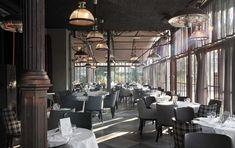 Restaurant 'L'Ille moeilijk te vinden ligt in een park op een eiland in de Seine. Super als het mooi weer om te lunchen