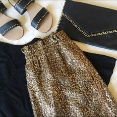 """J. Crew Sequin Mesh Bell Skirt Great condition, no damages. Gold skirt sits above waist. Side pockets. 100% polyester. Lining: 100% acetate. Size 2/ Size XS.  • Measured laying flat Waist 11"""" Length 16"""" J. Crew Skirts Mini"""