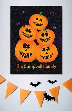 Dedicate some wall space for Halloween art, like this personalized Stacked Pumpkin Family canvas.